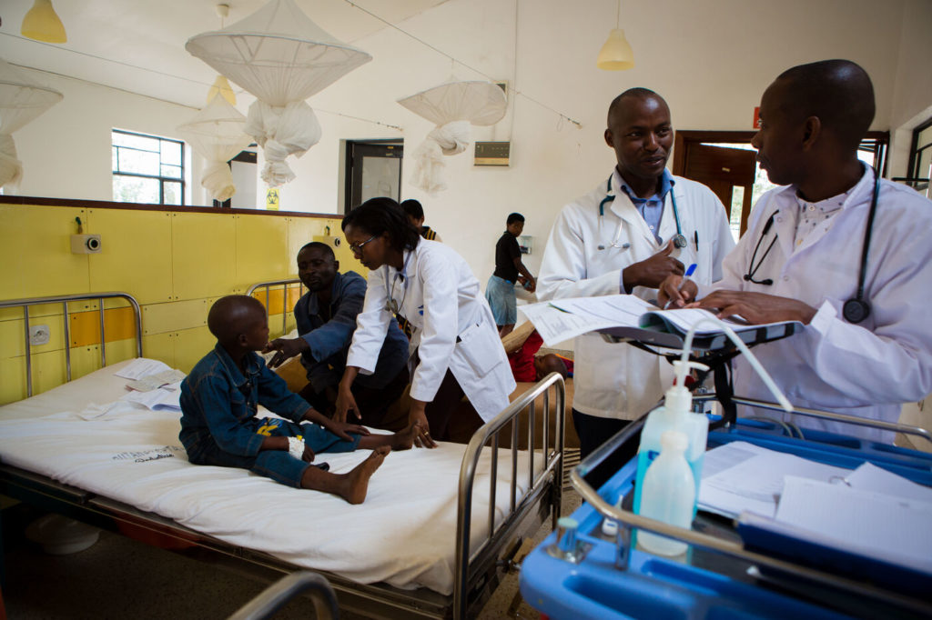 PIH staff care for Hodgkin's Lymphoma patient Wilson Ngamije at Butaro District Hospital in Rwanda.